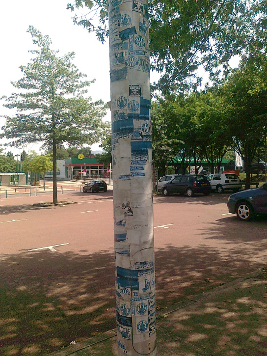 "The stadium as primary ""place of action"": a lamp post in the car park of Stade Geoffroy-Guichard, covered in stickers from both of Saint-Étienne's ultras groups (photo © B. Ginhoux)"