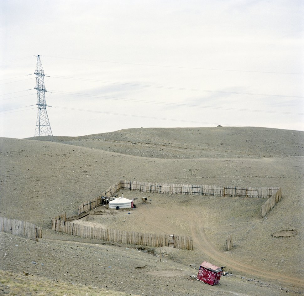 <p>The latest arrivals to the capital. Plots of land are distributed by the state : every citizen has the right to a plot of land of their choosing. If the plot is available, the family marks out its boundaries with wooden fencing.</p> <p>The end of the yurt neighbourhood, Uliastai, Ulan Bator, April 2011.</p>