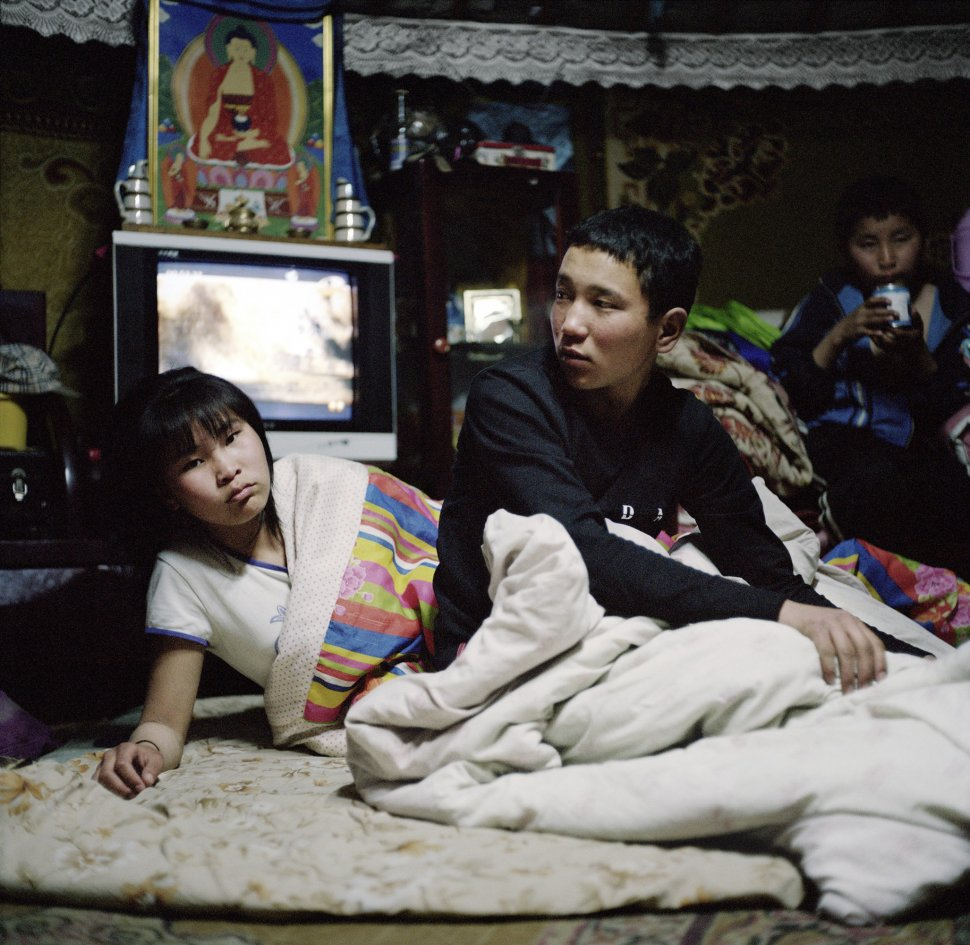 <p>Narantyua and Byambadorj get ready for bed. Some family members sleep in beds located close to the walls ; the rest of the family sleep on the floor with blankets. Sleeping arrangements such as these sometimes persist even among families who live in houses or apartments in the city.</p> <p>Bayankhongor, April 2011.</p>